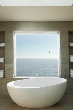 Bath with a view of the ocean.