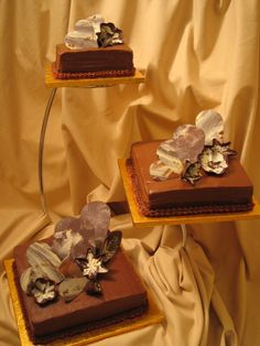 3 individual tiers of Sacher Torte #weddingcake decorated with chocolate work decorations...