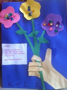 Homemade craft for mother's day. Trace and cut out child's arm with handprint and have it hold this stem of paper flowers. Poem included too!