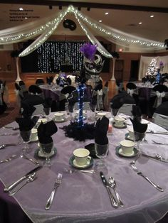 Purple, silver and black Masquerade themed holiday party at Swiss Park Banquet Center Whittier, CA. Lighting, columns and centerpieces courtesy of A Special Event Decor.