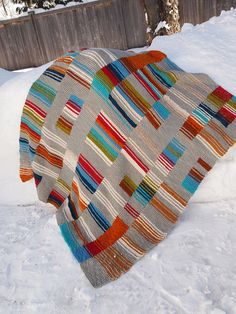 Strips and stripes by craftivore - No pattern but not necessary ; all done in garter stitch. I love the colors. Beautiful blanket !