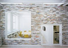 Stacked magazines! How AMAZING! What a great vibe! ~ Unconventional Office Interior from Elding Oscarson.