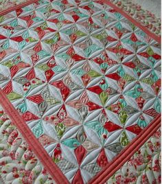 Beautiful colors and quilting!   http://sewkindofwonderful.blogspot.com/2012/09/before-and-after-quilting.html