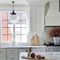Obsessed with @featherglass kitchen, this Dutchess pendant has so much character and charm with its Classic Schoolhouse Glass Shape.  The quartzite countertops, hardwood floors and white shaker cabinets create a kitchen masterpiece. Beautiful job well done. #frenchcountrykitchen #kitchenpendents #Kitchenlighting #frenchcountrykitchenfarmhouse #frenchcountrykitchencabinets #traditionalkitchen #farmhousekitchen #traditionalkitchenlighting #farmhousekitchenlighting #kitchenremodel