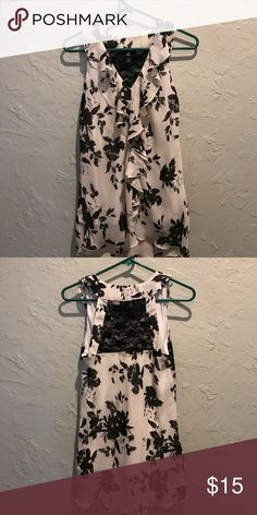 Sleeveless Top White with black floral print. Perfect for work - looks great tucked into black pants or skirt. Only worn twice! Iz Byer Tops Blouses