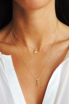 """A petite eight point star encrusted with cubic zirconia stones graces a 14K Gold Filled Chain in this simple and chic necklace. Closure: Lobster clasp. Materials: 14K Gold Filled, Sterling Silver Choose your length from drop down, 15"""" + a 2"""" extender or 18"""" + a 2"""" extender *2nd necklace for layering purposes only. Sold separately. Handmade in Corning, NY."""