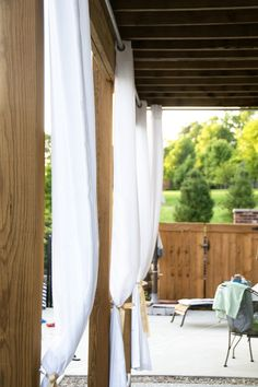 How to hang outdoor drapes. I have LOVED this idea since I first saw it on HGTV. Makes the backyard more elegant & inviting. Makes me want to grab a bottle of Moscato........