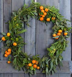 DIY winter citrus weath. Using a mixture of kumquat branches, seeded eucalyptus and acacia, you can create a quick and easy winter wreath that smells delicious (seriously, it's like an all-natural room freshener) and brings a little color to a seriously dreary season.
