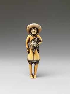 Netsuke of a Foreigner Carrying a Cock  19th century