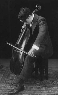 Charlie Chaplin + Cello, 1915... amongst my faves! ~ thenudo