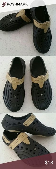 DAWGS black clogs shoes size 5 Velcro closure DAWGS black  clogs shoes.  Velcro closure. Size 5 feel free to ask questions I am not familiar with kids sizing Dawgs Shoes