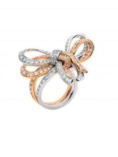 Van Cleef & Arpels 18k White And Pink Gold Diamond Noeud Ring. 18k White and Pink Gold with Diamond Bows.