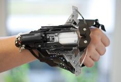 Homemade wrist crossbow gauntlet. That is pretty cool!