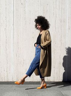 Photo via: Man Repeller Man Repeller gives us a great inside look at Nikisha Brunson's closet and we instantly fell in love with this particular look which consists of an easy tan coat, a basic black