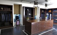 Custom Architectural Millwork by Munro Woodworking Ltd. Provided for Colton International, Richmond, BC - Men's Display