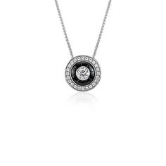 Stunning all over, this one-of-a-kind necklace showcases onyx and round brilliant diamonds framed in 18k white gold.