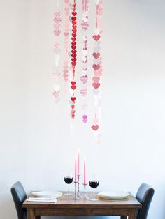 Create a paper heart chandelier and add a whimsical touch to your Valentine's Day dinner for two. By Michelle Edgemont , HGTV.com More From HGTV.com :