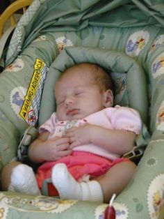 newborn girl in carseat