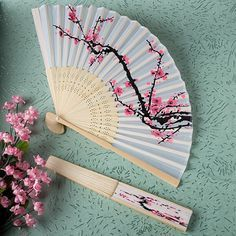 Cherry blossoms silk folding hand fan favors will add a splash of color with a nuance of the Far East to your summer wedding ceremony and reception.