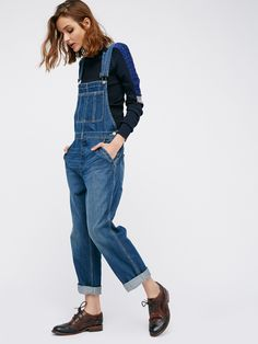 The Boyfriend Overall | Classic denim overalls in a slouchy boyfriend fit with double pockets on the bib and snap closures.    * Rigid, no-stretch fabric.     * Adjustable straps.    * Four-pocket styling.