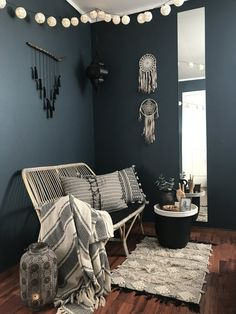 Ruth has used 'Oslo' by Jotun here in her home, an absolutely beautiful blue next to those dark wood floors and textures...... I love the long mirror on the wall, which not only looks super stylish but helps to bounce the light from the door opposite back into the room @norwegianboheme