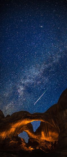 perseid meteor at double arch.  arches national park utah photo by thomas o'brien www.tmophoto.com