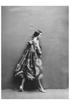 Carmen dell'Orefice Dior Wearing Pierre Cardin sacque coat of rose brocade, falling stiffly from a wide-away collar 1957 Photos  Richard Avedon