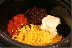 Dump Chicken burritos.   Frozen chicken, can of black beans, can of corn, can of rotel, and one package of cream cheese on low for 6-8 hours in the crock pot.  Shred chicken, make some rice, and stuff into a burrito shell.