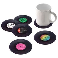 Keep your best furniture free from mug rings in true retro fashion with these Vinyl Coasters from John Lewis.   These little replica records make the perfect finishing touch for any retro home. Each pack has a selection of six vinyl coasters with quirky label designs that are sure to delight retro music lovers.      The Vinyl Coasters are £ 12 from John Lewis online.