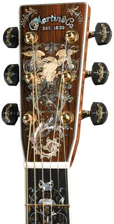Larry Robinson's inlay in the headstock and fingerboard of the millionth Martin guitar. Courtesy C.F. Martin and Co., He's so FaNcY