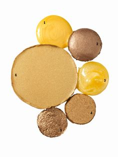 """GOLD CHEEKS, EYES, AND LIPS  --  """"The look of the season is definitely metallic—and if it isn't metallic on the clothes, it is on the face,"""" says makeup artist Pat McGrath. Our favorite shade: gold. Choose a cream shadow and liquid highlighter on your lids and cheekbones, then a gold-flecked gloss on your lips."""