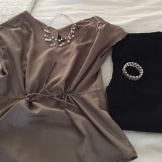 Gorgeous brown blouse!! Gorgeous brown blouse from banana republic!! Scalloped neckline and sleeves. Beautiful floral detail on shoulder and a cinch waist!! Banana Republic Tops Blouses