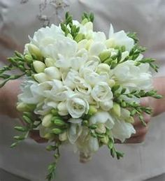 All white freesia bouquet. The Social Butterfly