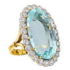 Elongated Oval Aquamarine Ring with Diamond Surround