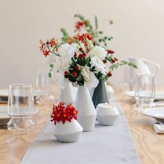 Modern holiday table setting featuring LINO vases and votive holders.