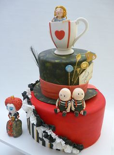 Alice Cake Tim Burton's Alice in Wonderland cake. Cakes covered in fondant, with edible gumpaste figurines and accessories