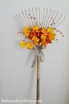 DIY Fall Welcome Rake ~I've been wanting to add a rake to my fall decor for a long time, and I finally found one! Here's how I fall-ified it!   From The House Down the Lane for Old House to New Home.