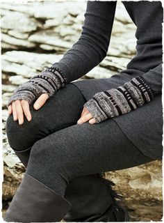 The artsy handwarmers are handcrocheted in tweedy ripples of black, grey, smoke blue and purple.