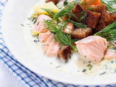 Finnish salmon soup with rye bread croutons