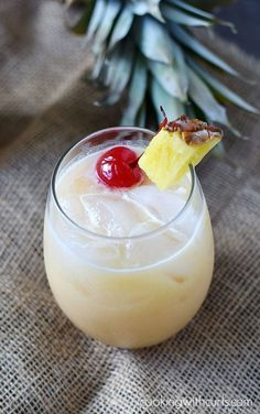 Tropical Painkiller 2 Ounces dark rum (I used Meyers's) 1 1/2 Ounces coconut milk (box) 3 Ounces orange juice 3 Ounces pineapple juice pineapple wedge and cherry to garnish (if desired. Fill cocktail shaker about half full with ice cubes. Add all ingredients, seal and shake. Pour into a small cocktail glass filled with ice and serve. Easy Cocktails, Summer Cocktails, Fun Drinks, Cocktail Recipes, Cocktail Drinks, Alcoholic Drinks, Cocktail Glass, Cocktail Shaker, Party Drinks
