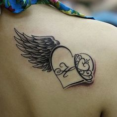 Wing and heart tattoo - 35 Breathtaking Wings Tattoo Designs  <3 !
