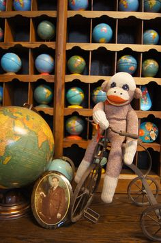 My sock monkey from 1968 and globes from forever