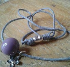 Necklace with purple handmade glassbead.