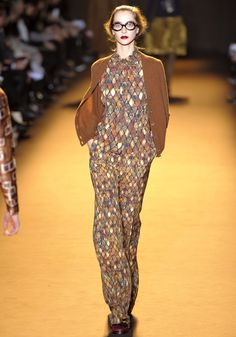 solid -print suits . dragon scales maybe? Rochas Fall 2012