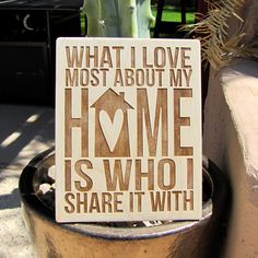 "Laser-Engraved Wood Sign ""What I Love Most About My Home Is Who I Share It With"""