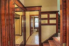 Oh, is that a stained wood bathroom? I wish the listing had a photo of it. Incredible European Birch woodwork. Beautiful leaded glass windows and cabinetry and lots of original period lighting. Has a newly remodeled kitchen with granite counters, new back splash, stainless appliances and new flooring. $339K Spokane, WA.