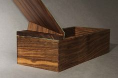 Fold box by Laurence Brand, made from black walnut and lined with turquoise pig suede.