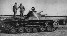 """A Type 97 """"Chi-Ha"""" tank with its crew"""