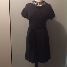 Marc by Marc Jacobs Sweet Sweater Dress Sweatshirt fabric. Puff sleeves, attached grosgrain ribbon belt, ruffle detailing on the back of the skirt Marc by Marc Jacobs Dresses Midi