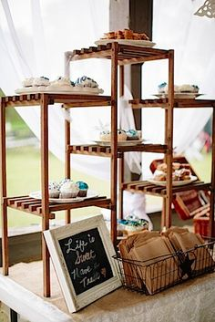 Absolutely love this wedding cupcake display.